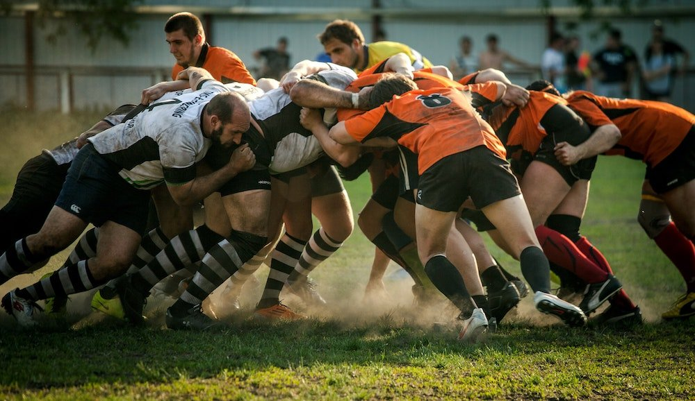 A group of rugby players in a scrum