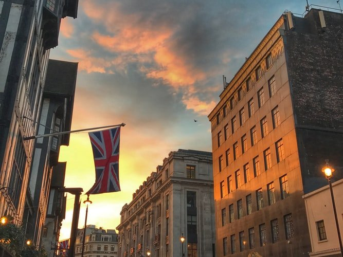 A Union Jack UK flag in London during sunset